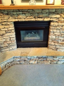 This is a picture of a fireplace in the basement of 325 Midvalley Place SE Calgary